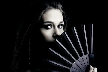 young woman portrait with fan, studio shot Stock Photo - 7021196