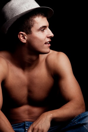 young handsome man with hat portrait, studio shot photo