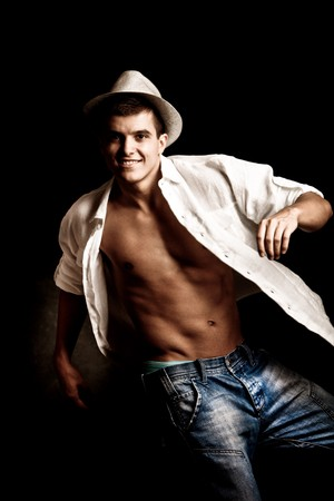 handsome young man in white shirt and hat in motion photo