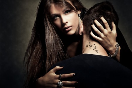 young woman and man  with  tattoo on neck Stock Photo - 7148755
