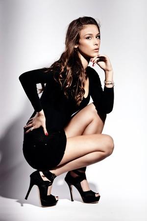 young fashion woman in high heels, studio shot photo