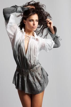 sexy young girls: beautiful brunette woman in elegant shirt, studio shot