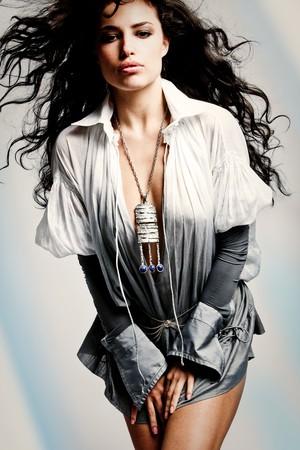 beautiful brunette woman in elegant shirt, studio shot Stock Photo - 7520900