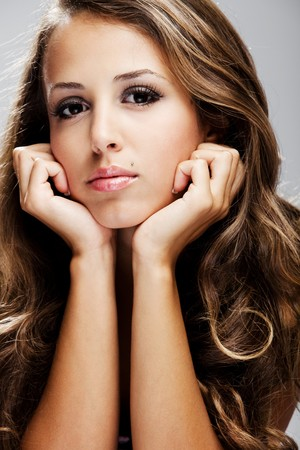 young brunette woman beauty portrait studio shot Stock Photo - 7444920