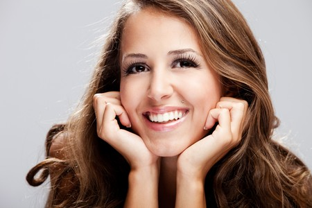 young brunette smiling woman, studio shot Stock Photo - 7445068