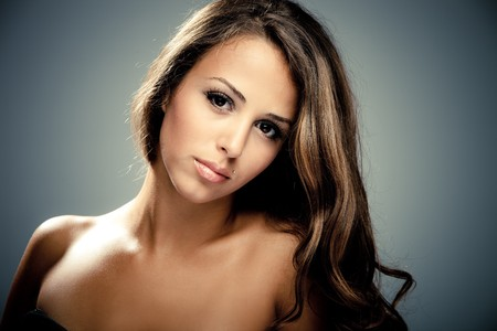 young brunette woman beauty portrait  studio shot photo