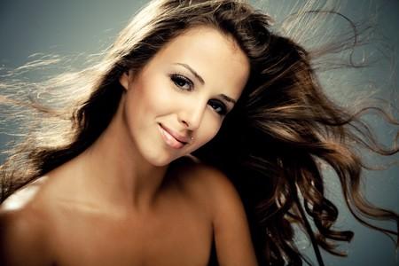 young brunette smiling woman, studio shot photo