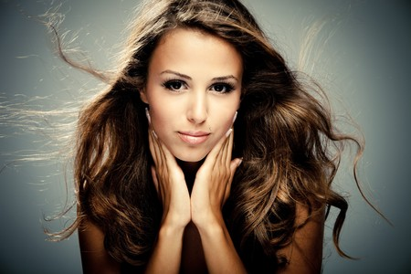 beautiful girl face: young brunette woman beauty portrait  studio shot