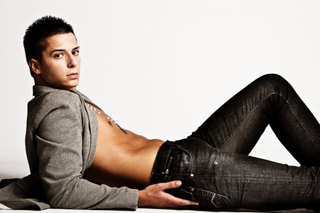 sexy male model: young handsome man in black jeans, studio shot Stock Photo