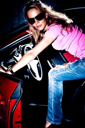 young attractive blond step in car photo