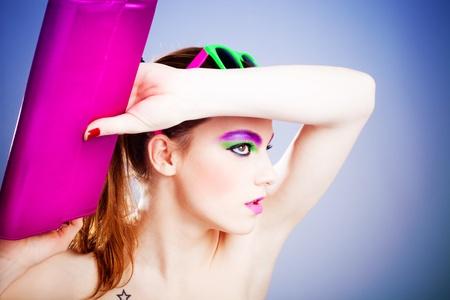 vanity bag: young woman beauty portrait holding vanity bag, studio shot