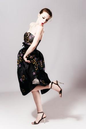 young woman in elegant high fashion dress, studio shot, full body shot photo