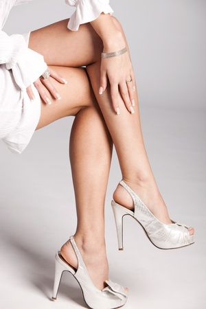 woman legs in silver high heels shoes, studio shot photo