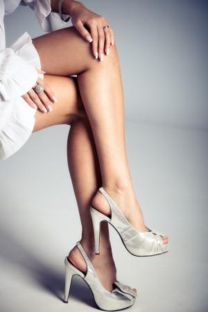 elegant female legs in high heels, studio shot photo