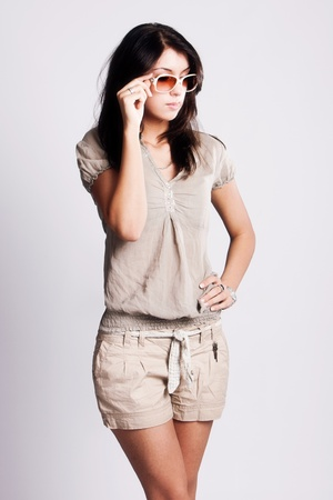 summer clothes: young brunette woman in summer clothes and sunglasses