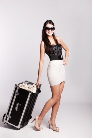 summer clothes: young woman in summer clothes with big luggage, full body shot, studio shot Stock Photo
