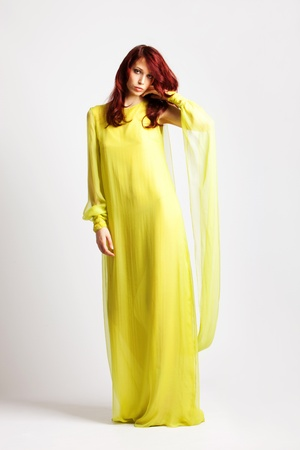 red hair woman in long elegant stylish yellow dress, full body shot, studio shot Stock Photo - 8942791