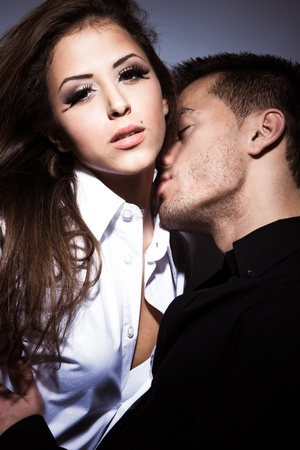 sexy young man: young couple in love kissing, studio shot