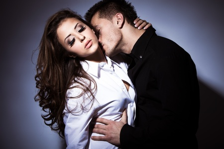 young couple kissing: young couple in love kissing, studio shot