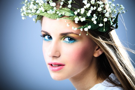 young blue eyes blond woman beauty portrait with wreath of flowers Stock Photo - 9165309