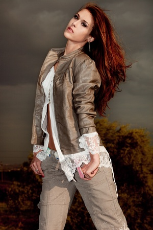beautiful brunette woman in leather jacket and white shirt outdoor portrait  photo