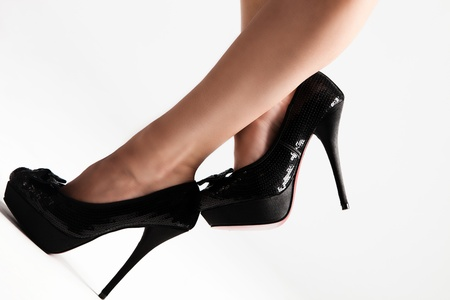 woman legs in high heel shoes, studio shot photo