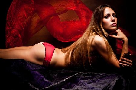 seductive: sensual woman in underwear studio shot dark background