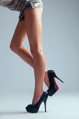 woman legs: long woman legs in high heel shoes, studio shot, side view Stock Photo
