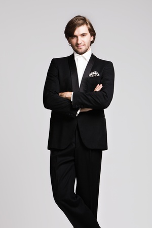 elegant young man in black tuxedo, portrait, studio shot Stock Photo - 10019303