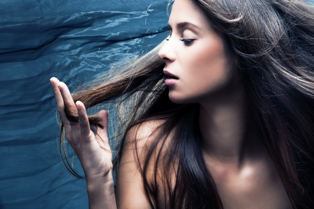 wild hair: sensual woman portrait, long hair in motion, profile, studio shot Stock Photo