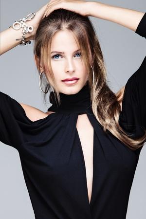 beautiful blue eyes woman in black dress, studio portrait 免版税图像