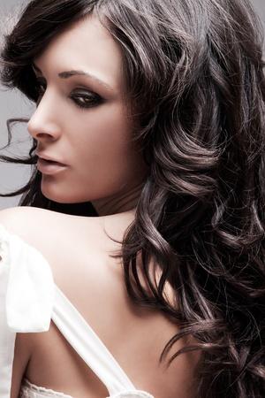 beautiful female with long wavy hair black hair, studio portrait Stock Photo - 10480424