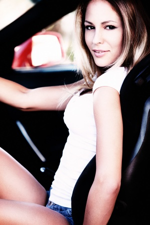 sexy woman car: young woman sitting in the sport car