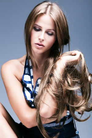 long silky hair: beautiful young woman beauty portrait with long blond hair, studio shot, vertical