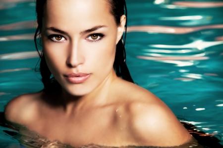 beauty: young woman beauty portrait in water