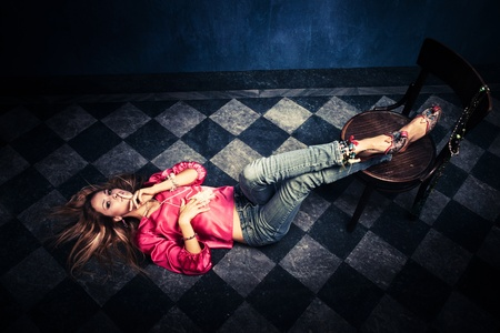 women in jeans: woman in oriental shirt and shoes lie on floor show sign of  silence with finger on lips