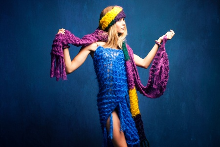 mohair: young woman in wool scarfs, studio shot
