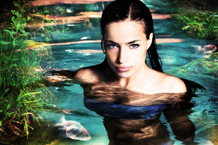 beautiful fantasy woman in water photo