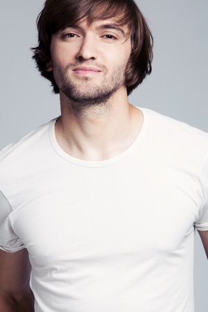 young man long hair in white t-shirt portrait photo