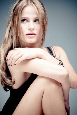 sexy black dress: blue eyes blond  woman portrait, studio shot Stock Photo