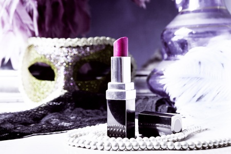dressing table: lipstick and pearls on dressing table Stock Photo