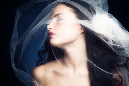 sensual nymph under white veil