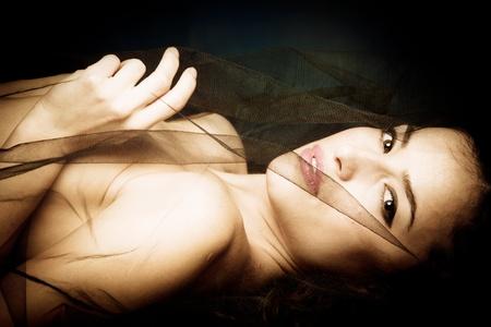 sensual beautiful woman under black veil photo