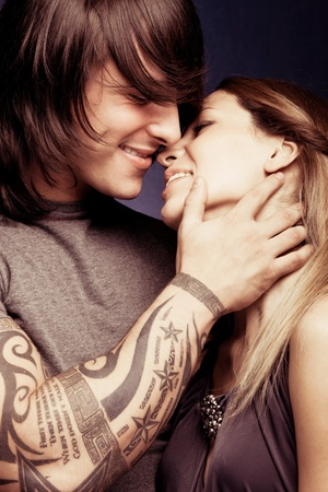 modern love: young beautiful smiling couple in hug