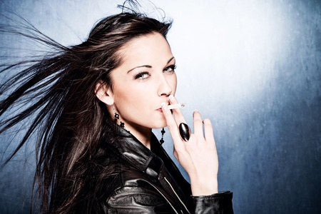 black hair woman in leather jacket, smoking, studio shot photo