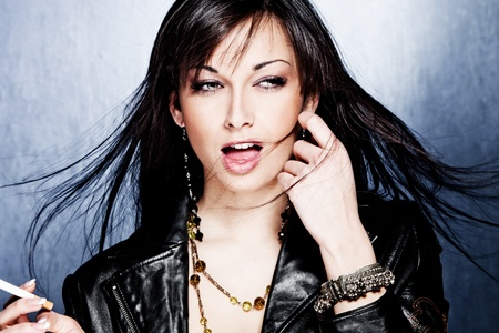 Bracelets: black hair woman in leather jacket, studio shot