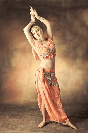 exotic belly dancer woman, small amount of grain added photo