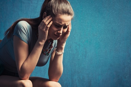 depressed woman: young woman crying, studio shot