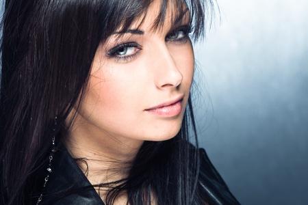 black hair blue eyes: blue eyes young woman portrait, studio shot Stock Photo