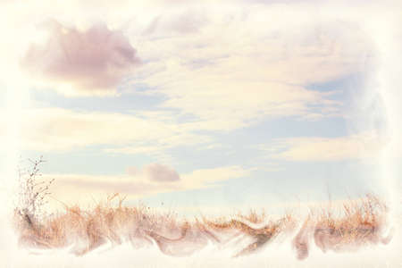 summer landscape  with yellow grass, blue sky and clouds, small amount of grain added and texture overlay photo